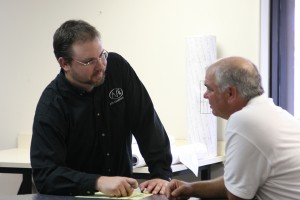 Steve & a client discussing a project